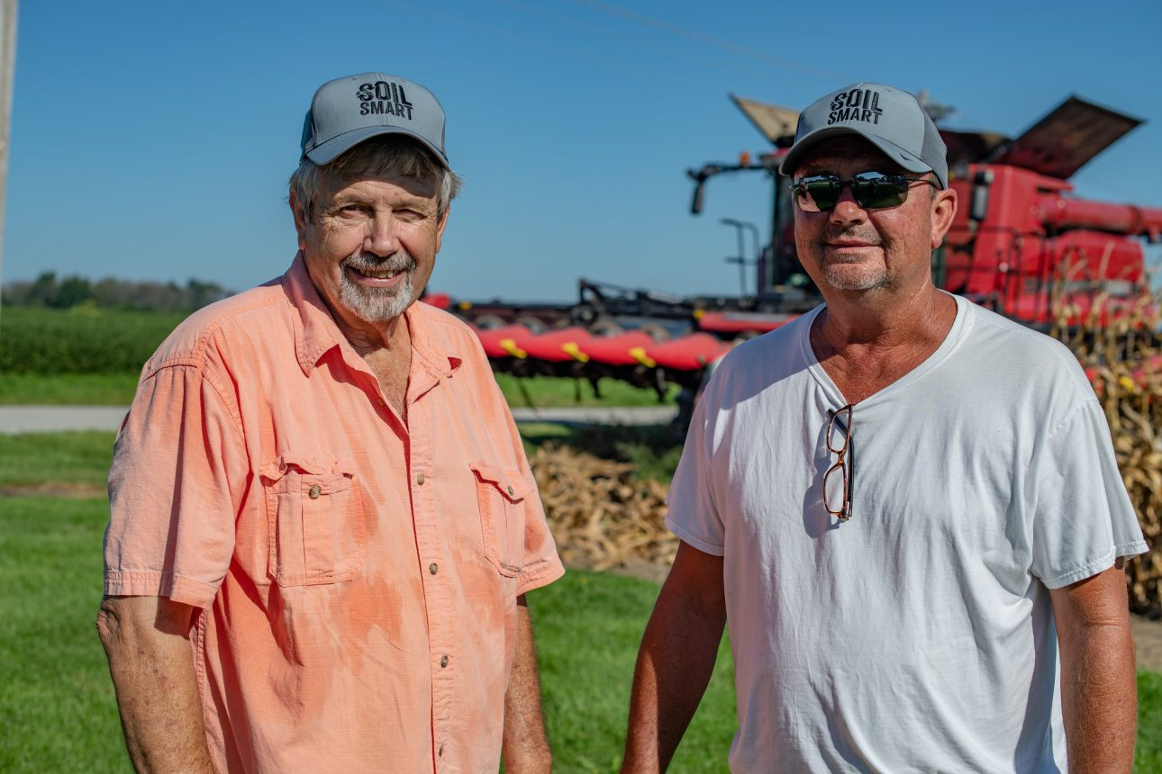 Mike Buis and farm hand