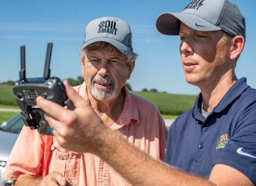 Two men look at drone
