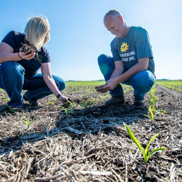Maddy and Ryberg looking at soil