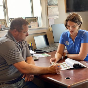 Carrie and Ryan Sanders reviewing data